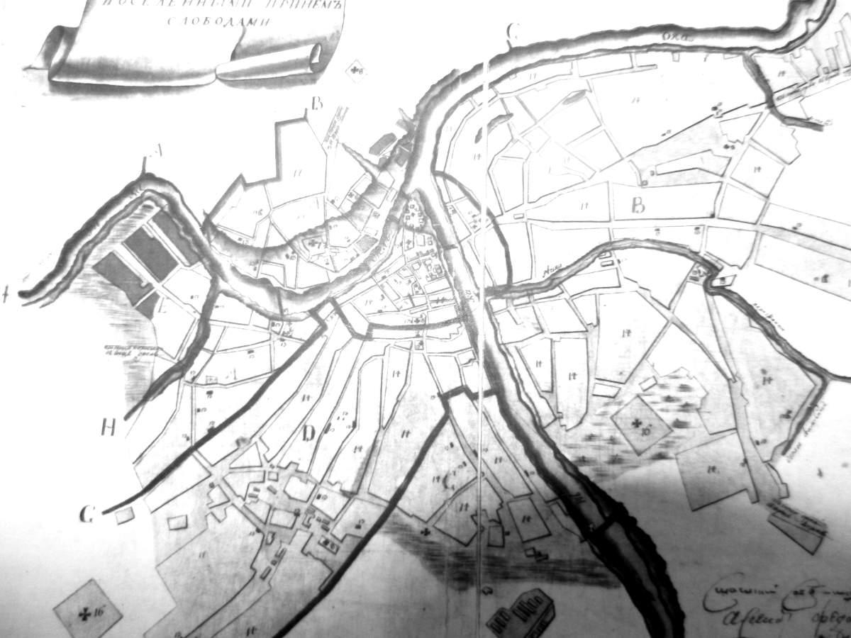 План города с реками и ручьями, толстыми границами между районами города и кривыми улицами.